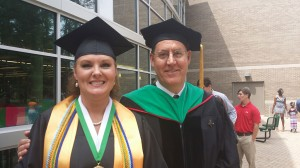 Julie Darley, recipient of the Outstanding Honor Graduate medal at Bainbridge State College's Spring 2014 commencement, stands with Dr. Dean Burke, who gave the commencement address at the ceremony, held at the Student Wellness Center at Bainbridge State College.
