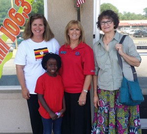 A Ugandan student who is part of the Ugandan Thunder singing and dancing group, comprised of orphan students from Africa, visited the Brunch to Lunch radio show on Wednesday, May 7. Pictured are Friendship House Director Missy Rollins, the Ugandan student named Retha, Brunch to Lunch host Melba Kay and one of Ugandan Thunder's chaperones.