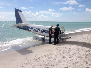 Investigators look at the plane that crash-landed Sunday afternoon on Caspersen Beach in Venice, Fla. (Photo: Sarasota County Sheriff's Office)