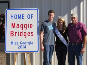 Miss Georgia Maggie Bridges and her brother, Maddox, and father John Bridges Jr.