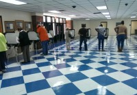 People casting their ballots on electronic voting machines at the Decatur County Memorial Coliseum