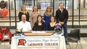 Meagan Harrison signs a letter of intent to accept a scholarship to play softball for LaGrange (Ga.) College as her parents Keith and Kristi Harrison and some of her teammates and friends look on.