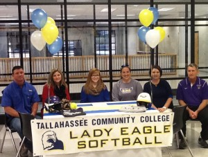 Brooke Bates signs a letter of intent to play softball for Tallahassee (Fla.) Community College as her parents, Brad and Denise Bates, and her high school and college coaches look on.