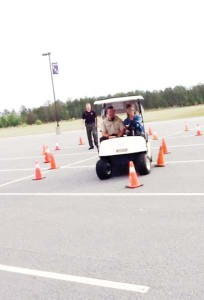 Under the supervision of Decatur County Sheriff's deputies, students drove golf carts through a traffic cone course — the catch was that they were wearing special goggles that simulated the effects of driving while impaired by alcohol or drugs, making the course very hard to manuever through correctly.