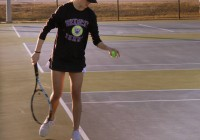 Bainbridge Lady Cats tennis player Taylor Greene prepares to serve during a recent match. | Photo by Lee Greene