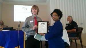 Grace Christian Academy senior Joshua Carnes accepts his STAR student plaque from BHS' Vonda Hubbard.