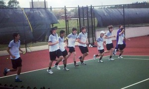 The Bainbridge High School boys tennis team warms up before a match against Colquitt County. | Photo by Mike Albritton