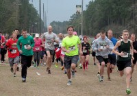 Both 5K and 10K racers begin strong as they make their way around the Bainbridge State College perimeter Saturday morning. | Photo Courtesy Herb Wills