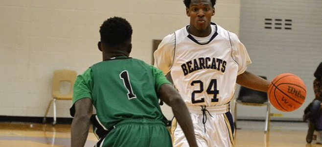 Bainbridge's Tyree Crump, in white jersey being guarded by Seminole County's Jordan Harris (in green).