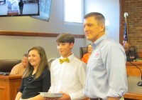 Hutto Middle School students Piper Loeffler and Michael Conder, who were the local 'If I Were Mayor...' essay contest winners, pose with Bainbridge Mayor Edward Reynolds at a City Council meeting.