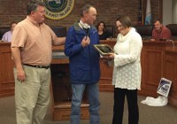 Presenting Mike with an award plaque and check were City Councilwoman Roslyn Palmer, City Manager Chris Hobby, and Public Works Director Steve Winburn.