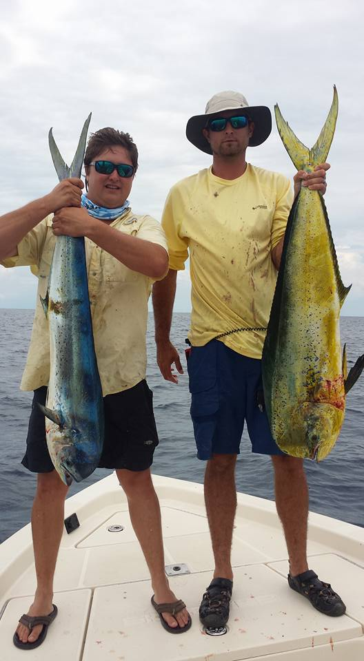 CLICK TO ENLARGE Tripp Powell (left) and Skylar Smith (right) pose with two mahi mahi they caught off the coast of Panama City, Fla., on June 7. Both men are from Bainbridge, Ga.