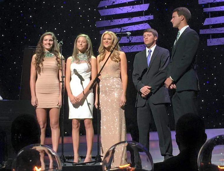 """Miss Georgia 2014 Maggie Bridges, center, sings """"In Christ Alone,"""" accompanied by her four siblings, during the Miss Georgia 2015 preliminaries on June 19."""