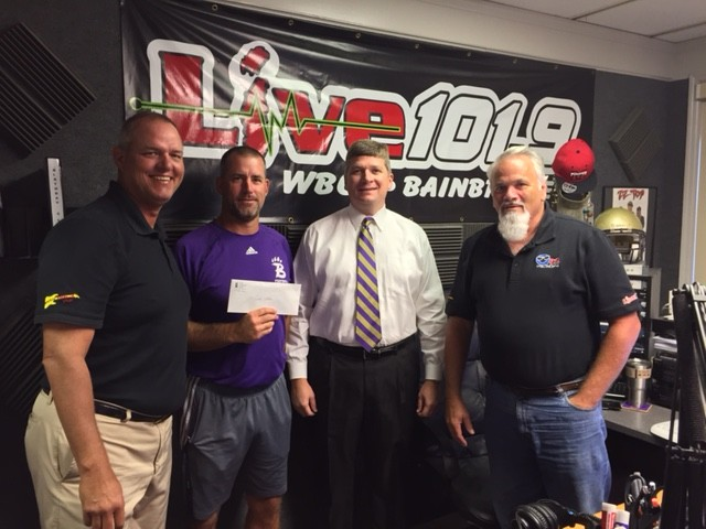 From left to right, Jesus and Jammin' Co-Host Jay Palmer, Bainbridge High School head football coach Jeff Littleton, First National Bank of Decatur County CEO Brad Barber and Jesus and Jammin' Co-Host Kevin Dowdy.
