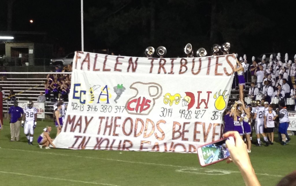 Pregame -- BHS cheerleaders display banner that players run through. Photo by Heidi Chambers