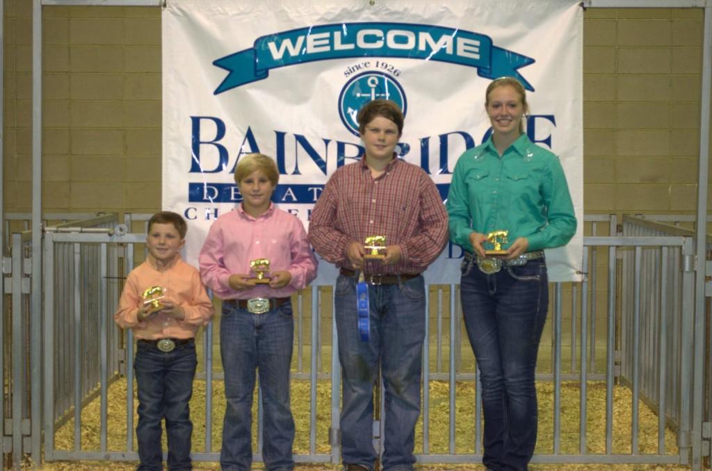 Swine Showmanship Winners L-R: Preston Lynn, Blake Fagan, Asher Childs, Kelsie Norton