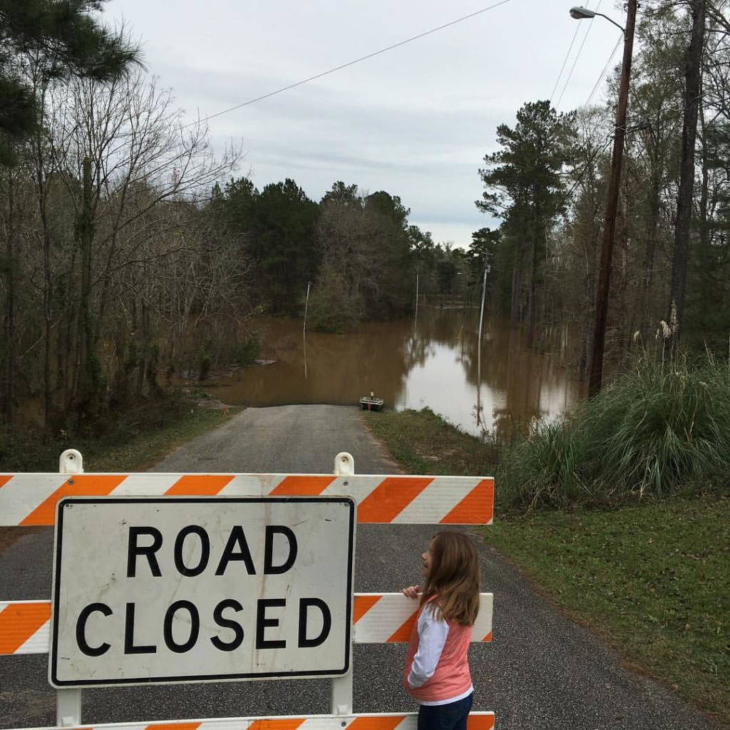 Emma Ryan Shirley checking out the flooding in River Vale subdivision, north of Bainbridge along the Flint River